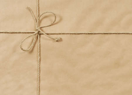 Brown paper parcel background with string and copyspace 스톡 콘텐츠