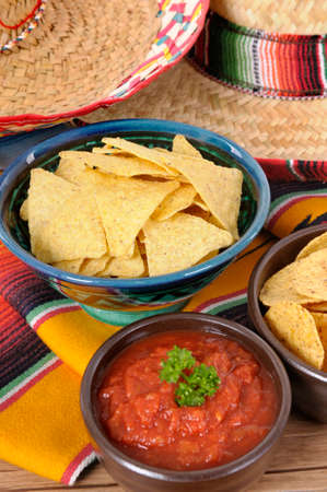 serape: Mexican sombreros and traditional serape blankets with salsa dip and tortilla chips.