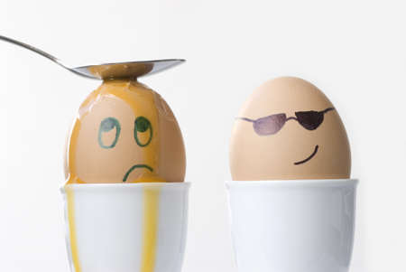 cracking: Cool dude egg dishes out punishment. Stock Photo