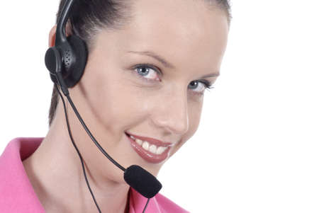 telephonist: Lovely female telephonist with headset and enigmatic smile Stock Photo