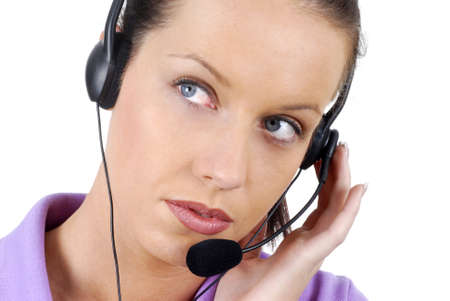 attentively: Attractive telephone worker listening attentively to a customer