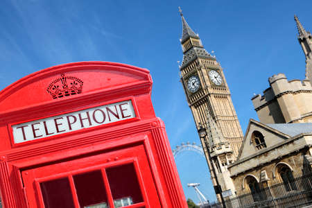 telephone box: Traditional red telephone box with Big Ben out of focus in the background.