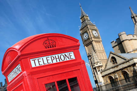 telephone box: London traditional red telephone box with Big Ben in the background.