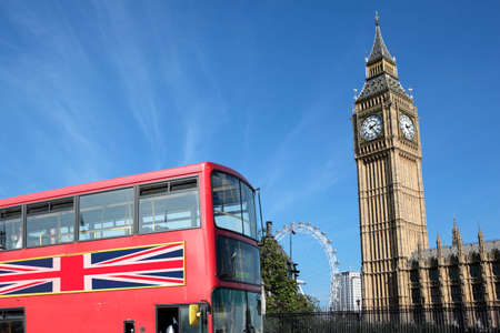 Traditional red double decker bus with Big Ben in the background.