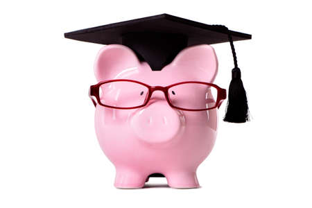 mortar hat: Pink piggy bank dressed as a college student with mortar board and glasses.  Isolated on white.