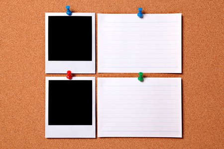 Blank photo prints and white message cards pinned to a cork notice board.  Space for copy.  Paths provided. photo