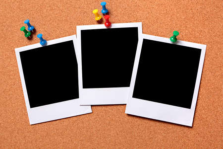 provided: Three blank photo prints pinned to a cork notice board.  Pathe provided.