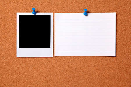 Blank photo print and office index card pinned to a cork notice board.  Space for copy. photo