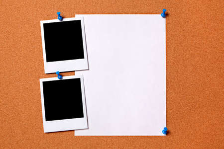 Blank photo prints and plain paper poster pinned to a cork notice board.  Space for copy. photo