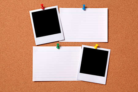 Blank photo prints and office index cards pinned to a cork notice board.  Space for copy. photo