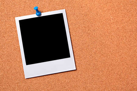 Blank photo print pinned to a cork notice board.  Space for copy. photo
