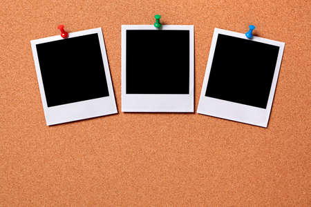 Three blank photo prints pinned to a cork notice board.  Space for copy.  Paths provided. photo