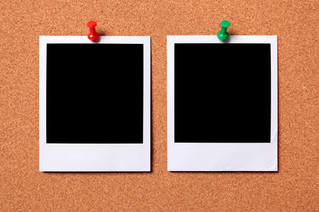Two blank photo prints pinned to a cork notice board.  Space for copy.  Paths provided. photo