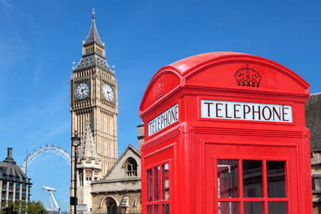 telephone booth: London traditional red telephone box with Big Ben in the background.