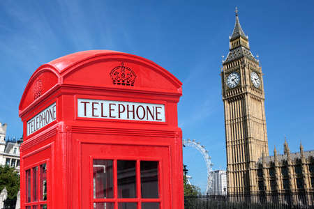 London traditional red telephone box with Big Ben in the background. photo