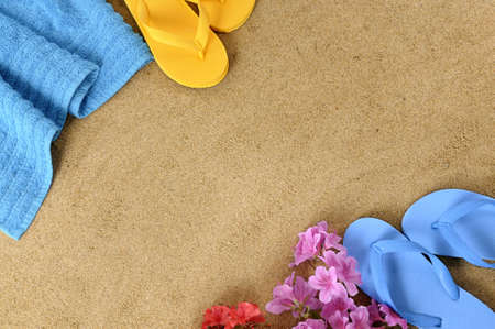 flops: Beach background with towel, flowers and flip flops