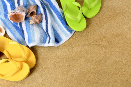 flops: Beach background with towel and flip flops