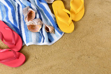 towel beach: Beach background with towel and flip flops