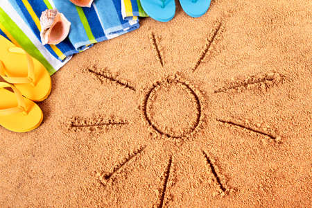 beach towel: Beach background with sun drawn in the sand.