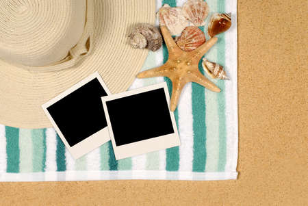 beach towel: Seashore background with blank polaroid instant photo prints, shells, beach towel and starfish Stock Photo
