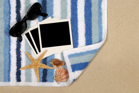 beach towel: Seashore background with blank instant photo prints shells beach towel and starfish