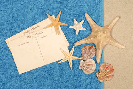 beach towel: Seashore background with postcards shells beach towel and starfish Stock Photo