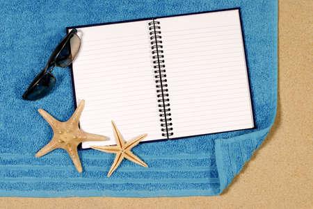 beach towel: Beach scene with starfish, towel, sunglasses and blank writing book