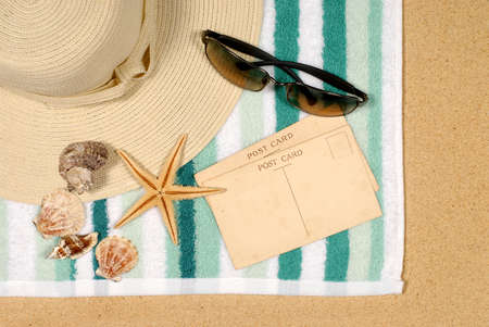 Seashore background with postcards shells beach towel and starfish photo