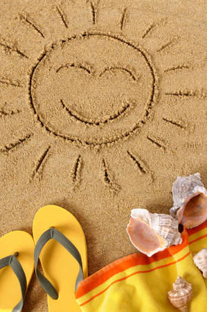 Beach background with sun drawing, towel and flip flops photo