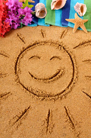 beach towel: Smiling sun drawn on an Hawaiian beach, with traditional flowers, beach towel, starfish and flip flops Stock Photo