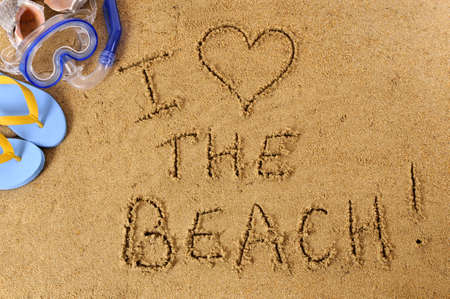 sand writing: Beach writing with scuba mask, seashells and flip flops