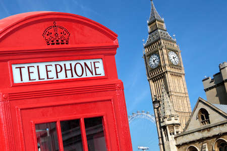 red telephone: Traditional red telephone box with Big Ben out of focus in the background.