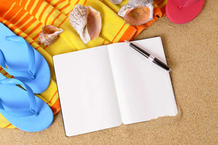 flipflops: Beach background with towel, flip flops and blank writing book.