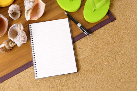 flip flops: Beach background with bamboo mat, flip flops and blank notebook.