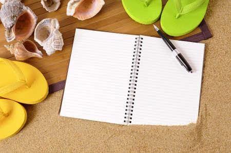 beach mat: Beach background with bamboo mat, flip flops and blank notebook