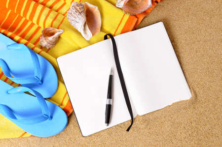 flops: Beach background with yellow towel, flip flops and blank writing book Stock Photo