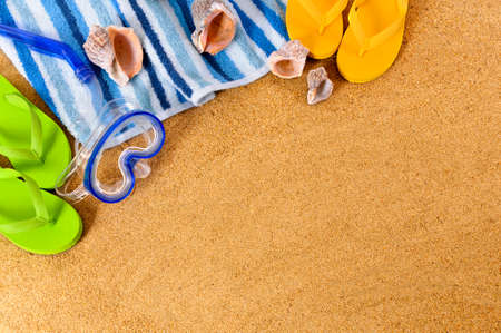 scuba mask: Beach background with towel, scuba mask and flip flops.  Space for copy.
