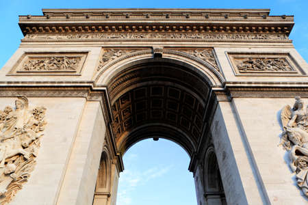 extreme angle: Extreme low angle view of the famous Arc de Triomphe in Paris.