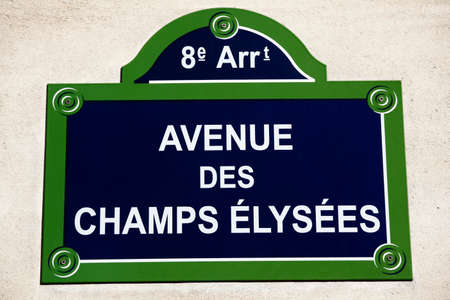 street name sign: Street name sign for the Avenue des Champs Elysees in central Paris.