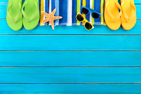 flip flops on the beach: Summer beach background border blue decking copy space