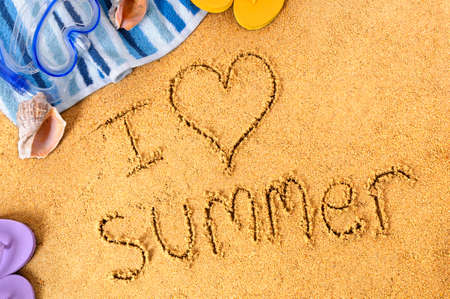 I Love Summer written in sand, with towel, seashells and flip flops photo