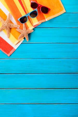 Tropical beach background vertical, sunglasses, copy space