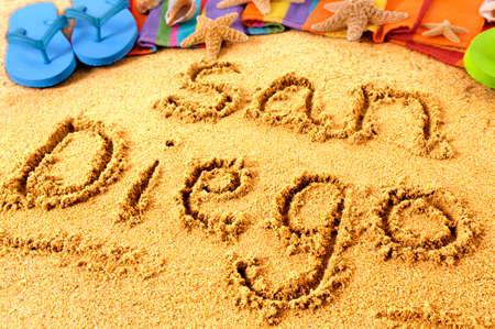 San Diego beach sand word writing