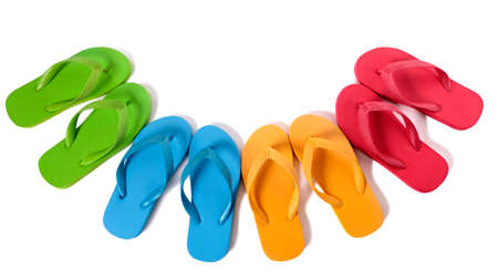 flip flops: Row of colorful flip flops isolated against a white background.