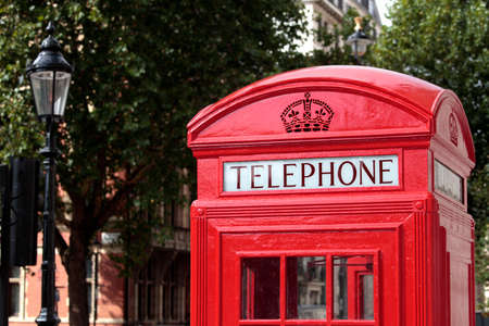 british english: Traditional red telephone box with out of focus background. Stock Photo