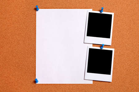blank photo: Blank polaroid photo prints and plain paper poster pinned to a cork notice board.  Space for copy. Stock Photo