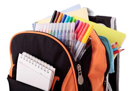 mochila escolar: Bolso de escuela con los libros y equipos