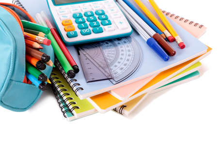 pencil case: Various school supplies including notebooks, calculator and pencil case isolated against a white background