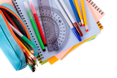 pencil case: Various school supplies including notebooks and pencil case isolated against a white background