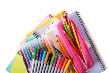 pencil case: Various school supplies including notebooks and pink pencil case isolated against a white background
